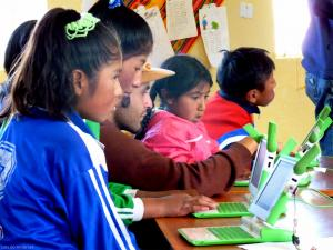 A group of girls making videos in Peru