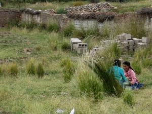 Two girls making a video using their XOs in Peru