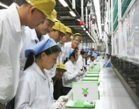 The XO laptops are mass produced at Quanta in Taiwan (copyright: unknown)