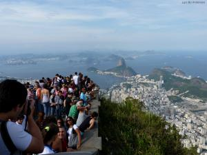 Tourists flocking to take pictures at the feet of Jesus in Rio, Brazil