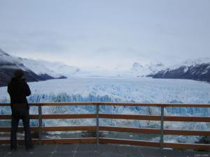 A tourist taking pictures from the viewing platform at the Perito Moreno glazier (Argentine)